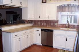 small kitchen design with brown false brick backsplash and white