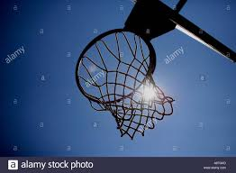 basketball rim hoop and net with sun outdoor basketball court