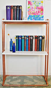 we built a bookshelf out of copper pipe and wood pipes