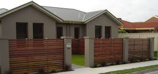 merbau timber feature front fence with rendered columns in