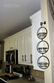 gray kitchen cabinets with white crown molding adding height to the kitchen cabinets tempting thyme
