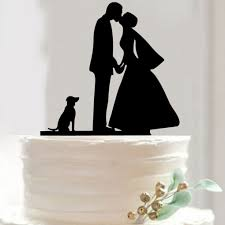 romantic cake topper bride kiss groom holding hands dog puppy