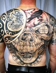 large owl and animal skull tattoos on full upperbody real photo