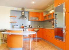 Bright Orange Kitchen Walls With Dark Stained Cabinets Paint It - Orange kitchen cabinets