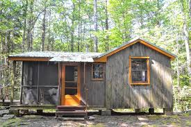 cabin styles the rustic cabins at temenos in shutesbury invite serious