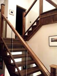 contemporary walnut staircase with glass detail private client