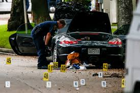 police porsche houston shooter wore emblems drove a porsche carried 2 600