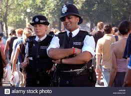 policeman and policewoman on patrol in the streets of notting hill