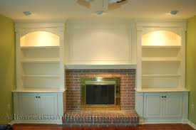 painted bookcases mantel with accent lights artisan custom