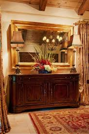 bright mirrored buffet in dining room mediterranean with buffet