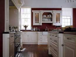 white cabinets and moldings contrast perfectly with burgundy or