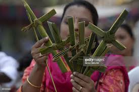 palm fronds for palm sunday an indian christian makes crosses of palm fronds during a palm