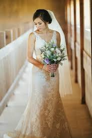 stone hill barn kansas wedding slim fitting lacey v neck wedding