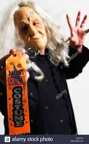 witch holding most original halloween costume award stock photo