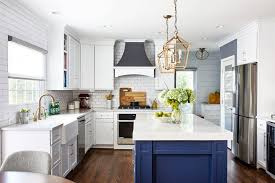 white kitchen cabinets with blue island what s trending in kitchen design