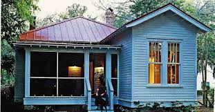 lovely blue living with a red tin roof this house would make a
