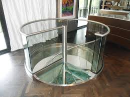 stainless steel and glass spiral stair in residence 9 foreman