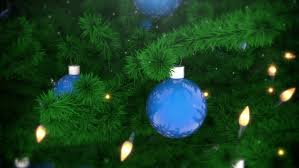 christmas tree decoration with balls and light bulbs falling snow
