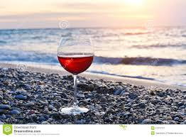 glass of wine glass of wine on the beach stock image image 11740861