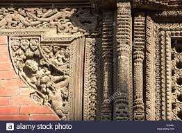 ancient ornately carved wood window frames on an building in