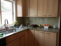 green glass tiles for kitchen backsplashes green glass subway tile with maple cabinets kitchen