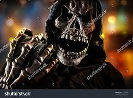 grim reaper on dark background halloween stock photo 217030990