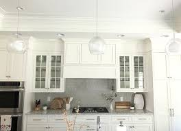 how to make cabinets go to ceiling how to fill space between cabinets and ceiling caroline on