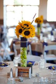 sunflower centerpieces sunflower centerpiece with apples in vase statice floral