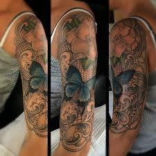 half sleeve with flowers and butterfly by jade tattoos