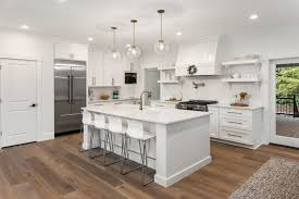 kitchen cabinets on top of floating floor harwood vs laminate flooring the pros and cons mymove