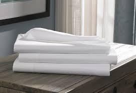 cotton vs linen sheets cotton stripe linens hilton to home hotel collection
