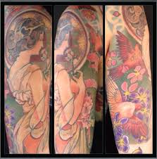 finished mucha tattoo done by shay bredimus outer limits tattoo