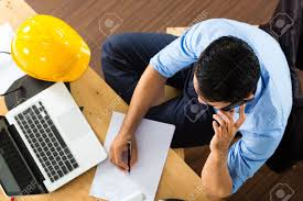 freelancer architect working at home on a design or draft