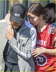 selena gomez nuzzles up to the weeknd at the grocery store photo
