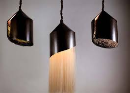 beautiful pendant lights displaying peacock feathers fur and