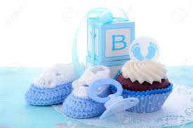 its a boy blue baby shower cupcakes with baby feet toppers and