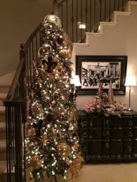 a beautifully decorated new orleans saints christmas tree