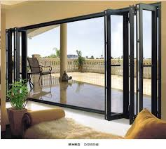 patio exterior accordion doors folding patio doors aluminium with exterior accordion doors folding patio doors aluminium with foliages in the vase and white fence outside