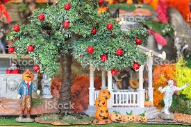 image of model halloween village with apple tree pumpkins monsters