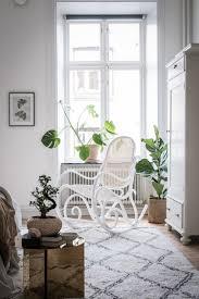 rocking chair and beni ourain rug in a swedish home full of