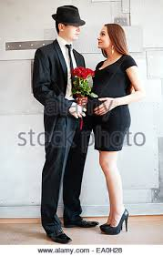 stylish elegant couple waiting a baby woman in black dress man