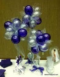 pretty balloon centerpiece in different shades of purple no