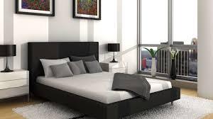 bedroom decor upholstered headboard black pillow white bedsheet