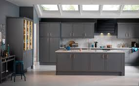 gray kitchen designs pair gray cabinets with warm colors and