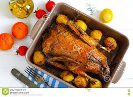 White Wooden Table Surface Top Flat View Of Roasted Duck Meat With Vegetables In Round