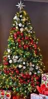 Decorated Christmas Trees by Christmas Tree Angled Gold Mesh Red Berries Gold Ornaments