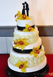 Black And White Wedding Cake With French Macarons And Yellow