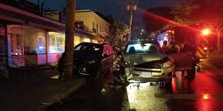 suv struck a tree parked car and utility pole