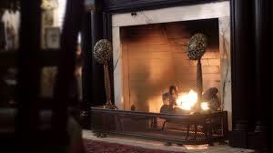 medium establishing shot of lit victorian fireplace in mansion