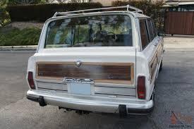 jeep grand wagoneer custom jeep grand wagoneer w wood paneling white tan restored v8 woody
